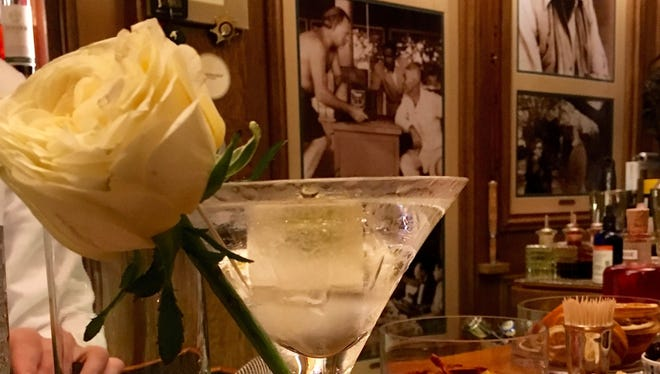"In this Sept. 15, 2017, photo, The ""clear"" dirty martini is shown and is a signature drink at Bar Hemingway at the Paris Ritz. Hemingway and other notable figures of Paris in the early 20th century are said to have drunk here."