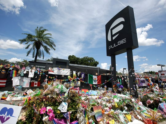 A makeshift memorial continues to grow outside the Pulse nightclub, the day before the one month anniversary of a mass shooting, Monday, July 11, 2016, in Orlando, Fla.