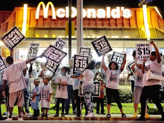 Pro-labor protesters chant outside the McDonald's on Poplar during a demonstration for higher wages for fast food workers. Dozens of workers and their children voiced their support of a $15 wage.