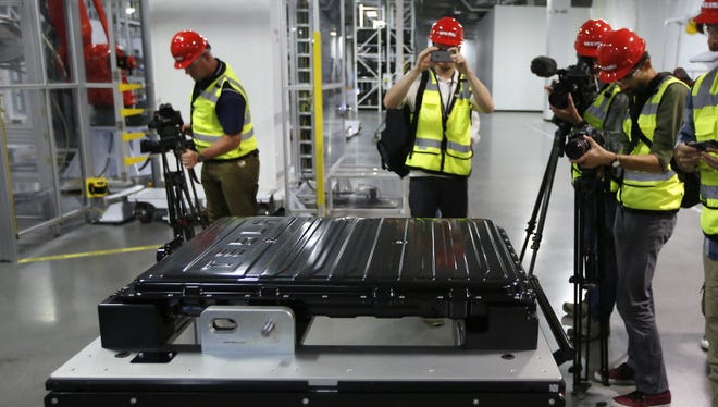A Tesla lithium-ion battery pack is displayed during a media tour of the new Tesla Motors Inc., Gigafactory, in Sparks, Nev.