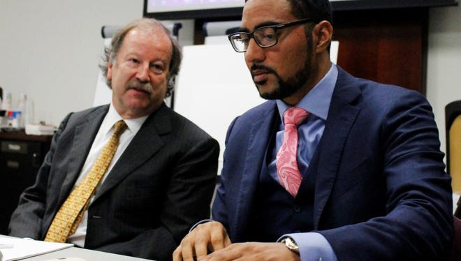 Attorneys Charles Monette, left and Justin Bamberg, chat prior to a citizens review board hearing in Charlotte, N.C., on Tuesday, Aug. 8, 2017. The attorneys represent the estate of Keith Lamont Scott, who was shot and killed by a Charlotte-Mecklenburg police officer last September. The board said it found potential error in the departments decision that the shooting was justified and convened a second hearing to address the finding.