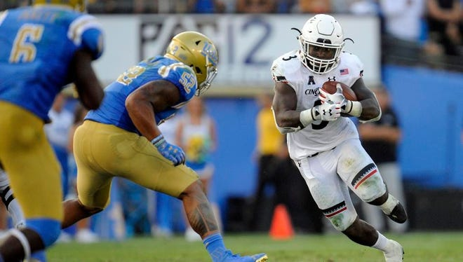 UC running back Michael Warren II runs for some of his 142 yards against UCLA on Saturday, in a 26-17 Bearcats upset of the Bruins.
