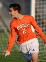 Northville's Andrew Mitchell celebrates after scoring a goal just 1:27 into the match at Novi.