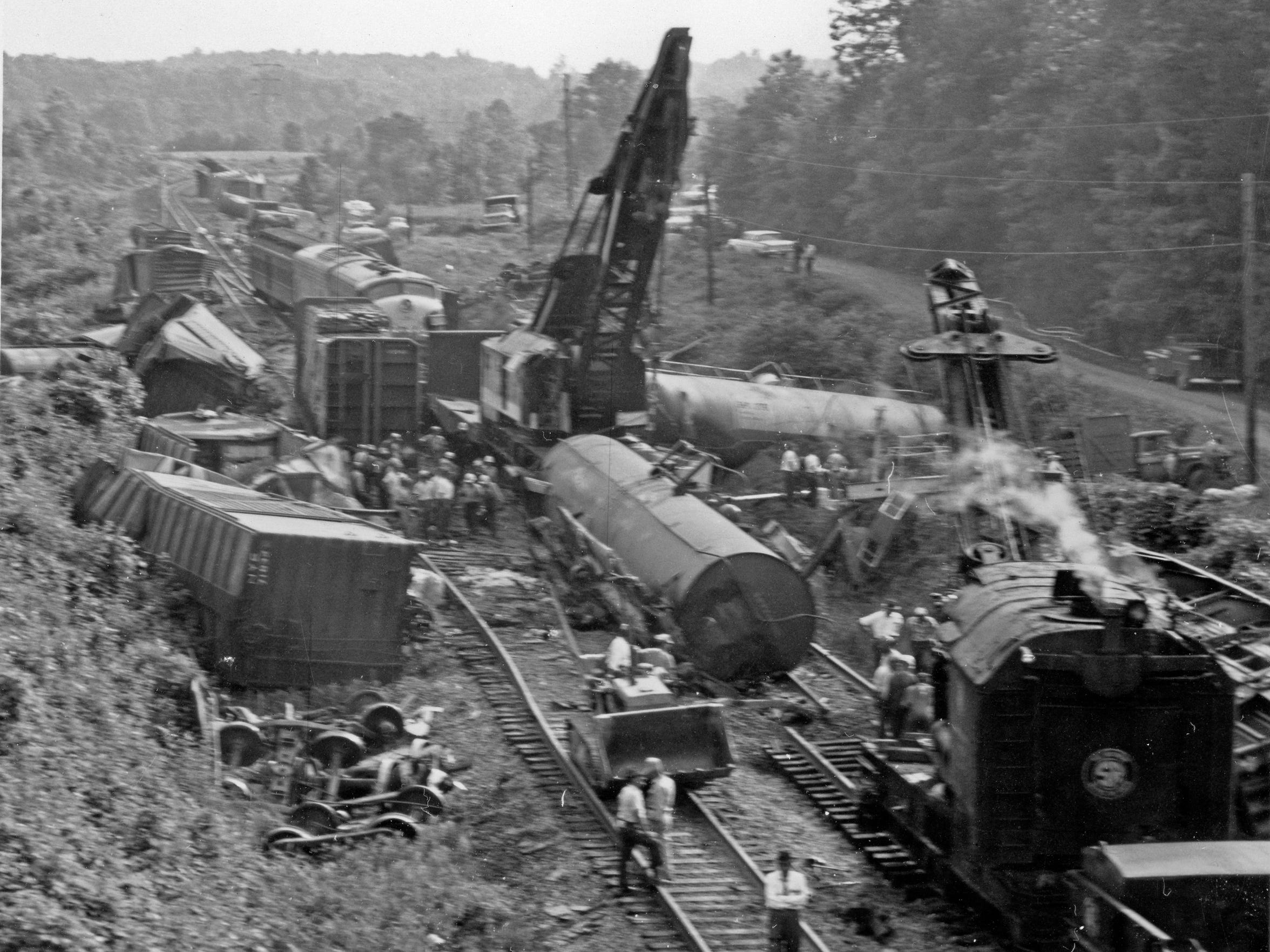 A pair of cranes working to clear wreckage at the Clemson