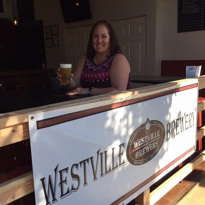 Westville Brewery co-owner and operations manager lifts