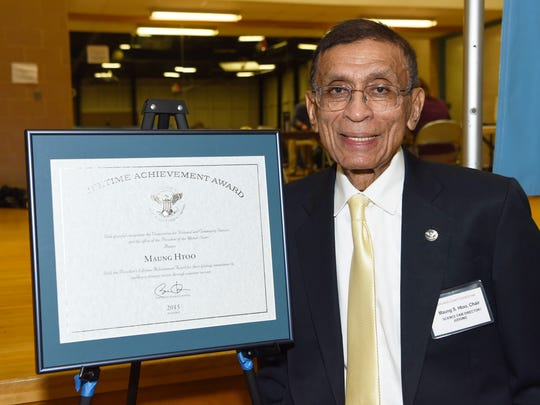 Maung Htoo, director of the Dutchess County Regional Science Fair, stands with the Lifetime Achievement Award he was given by former President Barack Obama in 2015.