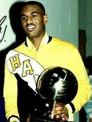 Roy Marble Sr. holds a trophy after becoming Iowa's