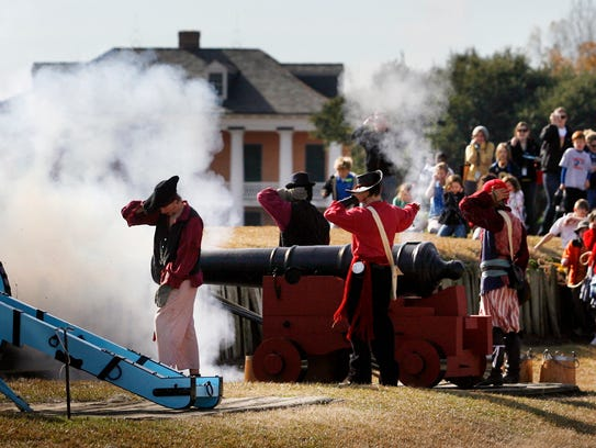 Re-enactors fire canons during the commemoration of