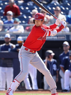 Shohei Ohtani walked twice and singled in his spring debut as a batter.