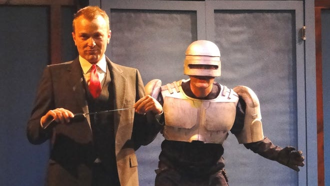 "Bryan Lark, left, and Sean May in ""RoboCop! The Musical."" May plays Officer Murphy, the Detroit cop who becomes part-cyborg, in the second — and larger — production of the Detroit-designed musical."