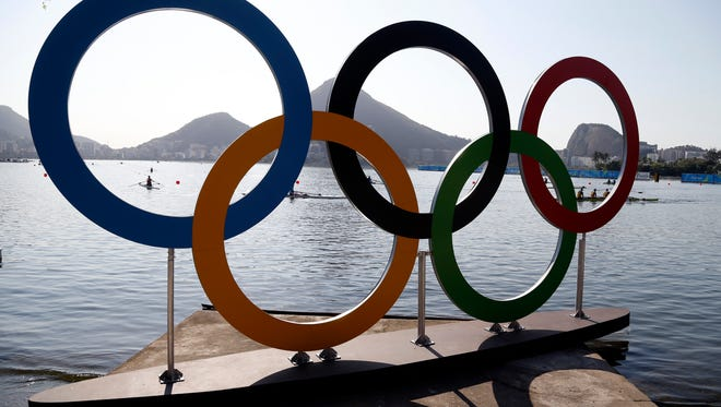 Rowers practice in Lagoa ahead of the the 2016 Summer Olympics in Rio de Janeiro, Brazil, Friday, Aug. 5, 2016. (AP Photo/Andre Penner)