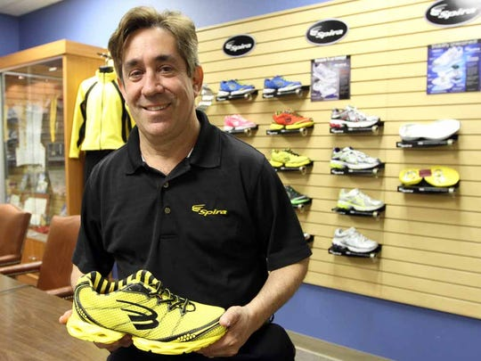 Andy Krafsur, founder of now-closed Spira Footwear, showed off one of the brand's spring-cushioned running shoes in 2013 inside the company's West El Paso office. He died April 25. He was 57.