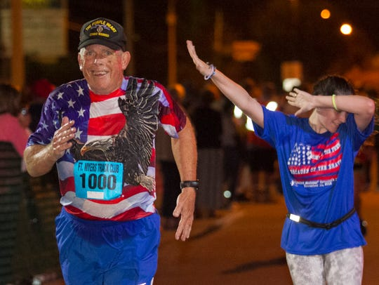 Greg Hill finishes the Veterans Day 5K last year in Fort Myers. Hill is a Purple Heart recipient for his service in Vietnam.