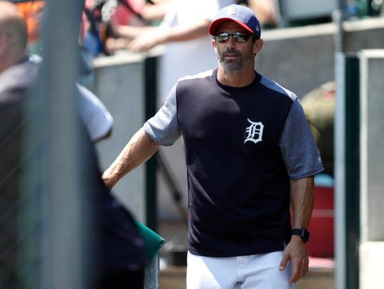 Tigers manager Brad Ausmus (7) walks in the dugout