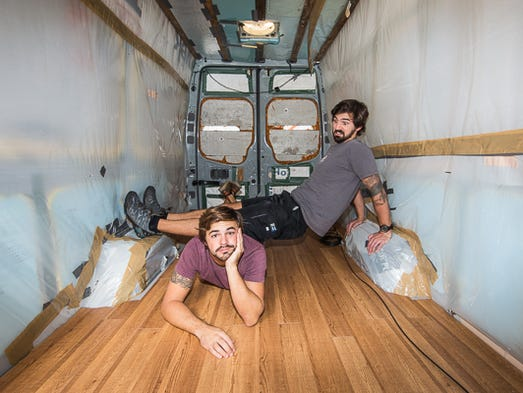 Before placing furniture in the sprinter van, brothers