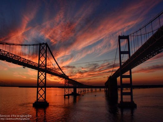 A colorful sunset sweeps over the Chesapeake Bay Bridge.