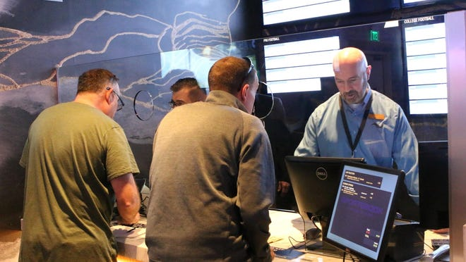 Tiverton Casino Hotel tellers help guests place their wagers at the sports betting window in December 2018.