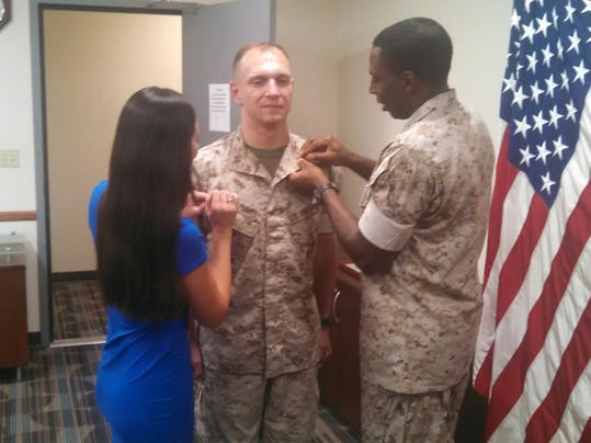 William McFarland receives his promotion to Captain from his wife Weixen and.jpg