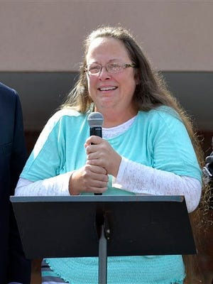 Rowan County Clerk Kim Davis speaks after being released from the Carter County Detention Center, Tuesday, Sept. 8, 2015, in Grayson, Ky. Davis, the Kentucky county clerk who was jailed for refusing to issue marriage licenses to gay couples, was released Tuesday after five days behind bars.   (AP Photo/Timothy D. Easley)