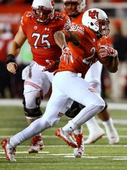 Utah running back Armand Shyne (23) carries against Arizona during the first half of an NCAA college football game, Saturday, Oct. 8, 2016, in Salt Lake City.