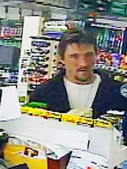 In this April 4, 2017 frame grab from a surveillance video released by the Rock County Sheriff's Office, Joseph Jakubowski makes a purchase at a gas station in Janesville, Wis. The hunt continues Monday, April 10, 2017, for Jakubowski, who is suspected of stealing firearms from a Wisconsin gun store and sending an anti-government manifesto to President Donald Trump.