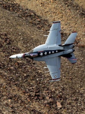 "In this Feb. 27, 2017, photo, Lt. Cmdr. Ian ""Elf"" Kibler of the VX-9 Vampire squadron from Naval Air Weapons Station, China Lake, banks his F/A-18E Super Hornet through the nicknamed Star Wars Canyon in Death Valley National Park, Calif. Military jets roaring over national parks have long drawn complaints from hikers and campers. But in California's Death Valley, the low-flying combat aircraft skillfully zipping between the craggy landscape has become a popular attraction in the 3.3 million acre park in the Mojave Desert, 260 miles east of Los Angeles."