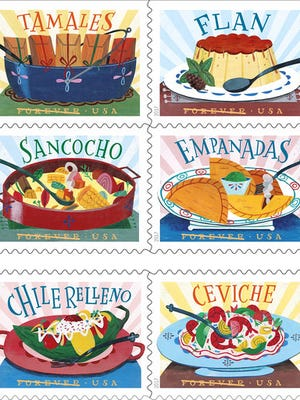 In this undated image provided by U.S. Postal Service shows six new stamps that The U.S. Postal Service is releasing. The tiny works of art are dedicated to the influence of Mexican, Central and South American and Caribbean foods and flavors on American cuisine. The dedication ceremony for the Delicioso Forever Stamps is being held Thursday, April 20, 2017 at the National Hispanic Cultural Center in Albuquerque, N.M.