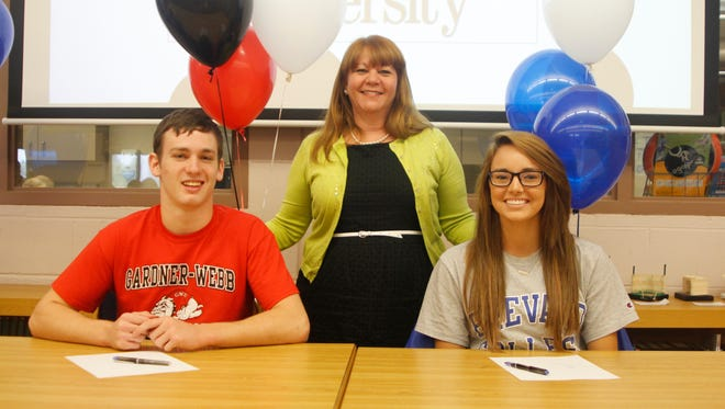 West Henderson cheerleaders Austin Learo and Maddie Tweed will continue their careers in college.