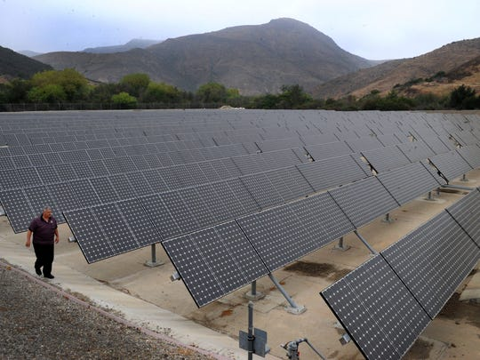 Santos Marquez, a laboratory supervisor for the Thousand Oaks Public Works Department, looks over the solar panels at the Hill Canyon Wastewater Treatment Plant in this file photo.