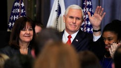 Vice President Pence with his wife Karen Pence, waves
