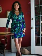 Angela Jo Manieri wears a Vera Wang floral wrap dress