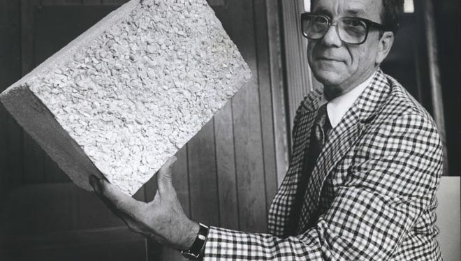 Architect Donald Grieb holds a polystyrene block in this photo from 1962. At the time, he hoped to build homes from the material.