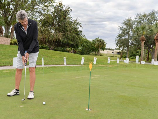 Bonnie Bohannon practices putting at the Oct. 27 Hunger
