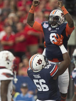 Auburn quarterback Jeremy Johnson (6) celebrates with Auburn offensive lineman Avery Young (56) after scoring a touchdown during the NCAA football game between Auburn and Louisville on Saturday, Sept. 5, 2015, in at the Georgia Dome in Atlanta, Ga.Auburn is one of 10 SEC schools in the AP Top 25 this week.