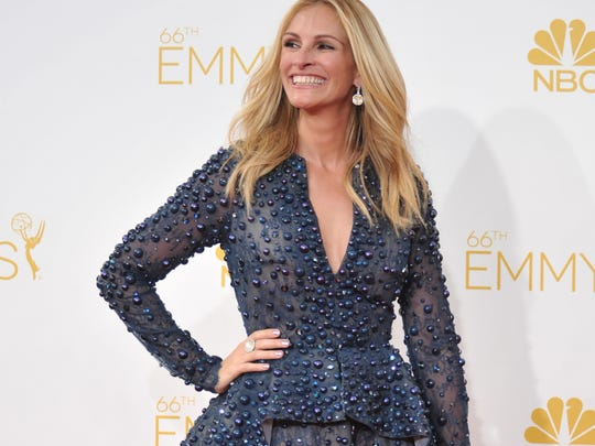 Julia Roberts arrives at the 66th Annual Primetime Emmy Awards at the Nokia Theatre L.A. Live on Monday, Aug. 25, 2014, in Los Angeles.