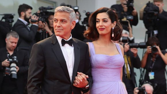 George Clooney and Amal Clooney walk the red carpet