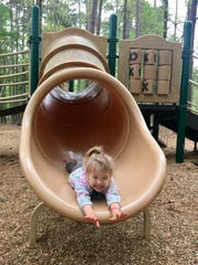 Avery Guidry, 3, slides at Lake D'Arbonne State Park.