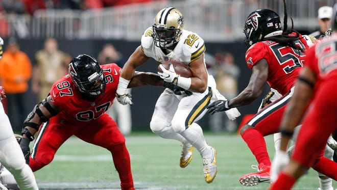 New Orleans Saints running back Mark Ingram (22) runs the ball against the Atlanta Falcons in the second quarter at Mercedes-Benz Stadium.