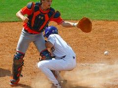Wild pitch, errant throw help LSU rally past Auburn 4-3