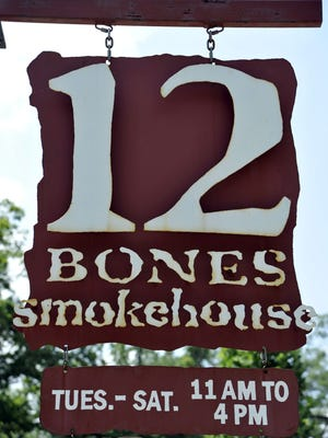 A sign of good barbecue: This hangs outside of 12 Bones Smokehouse's South Asheville store.