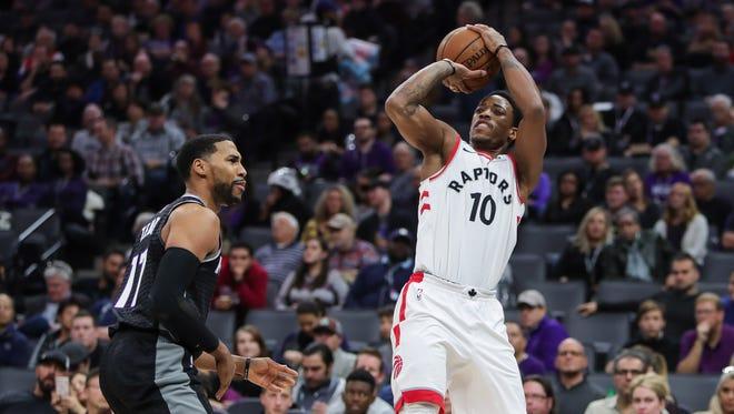 Toronto Raptors guard DeMar DeRozan (10) shoots the ball against Sacramento Kings guard Garrett Temple (17).