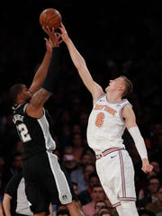 New York Knicks forward Kristaps Porzingis (6) blocks a shot by San Antonio Spurs forward LaMarcus Aldridge (12) during the first quarter of an NBA basketball game, Tuesday, Jan. 2, 2018, in New York. (AP Photo/Julie Jacobson)