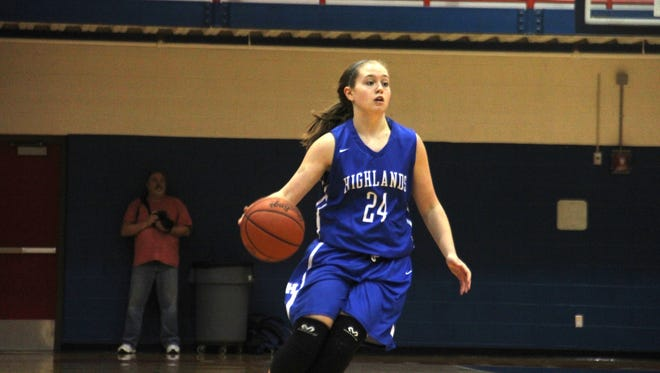 Highlands junior Lauren Epperson dribbles upcourt.