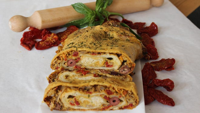 In Sicilian cuisine, a variation of calzone is called scaccia, which is a filled flatbread.