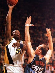 Indiana Pacers forward Adrian Caldwell (L) fends off the defensive efforts of Cleveland Cavaliars forward Danny Ferry (R) 21 April 1996 at Market Square Arena in Indianapolis. Caldwell contributed 10 points and 11 rebounds to the Pacers 89 to 88 victory over the Cleveland.  (Photo credit should read JOHN RUTHROFF/AFP/Getty Images)