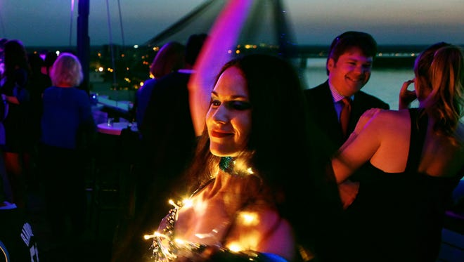 April 25, 2013 - (right) Dancer Amber Lea entertains crowds with belly dancing at the grand opening of the Twilight Sky Terrace on the rooftop of the Madison Hotel. (Kyle Kurlick/Special to The Commercial Appeal)