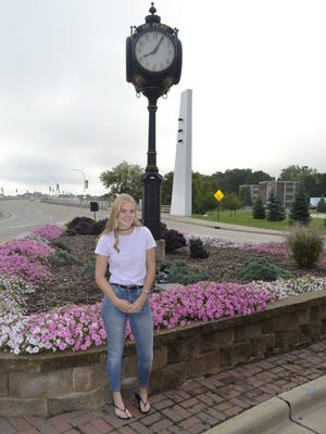 Exchange student Emilia Nilsson of Amal, Sweden, stands in front of the street clock on the west end of the Claude Allouez Bridge in downtown De Pere. Nilsson is attending De Pere High School for the 2016-17 school year.