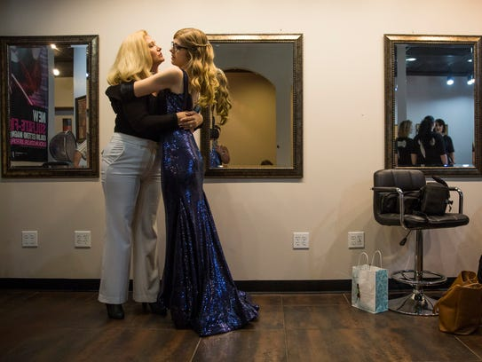 Amanda Berry, left, hugs her daughter Matheson Campagnolo,
