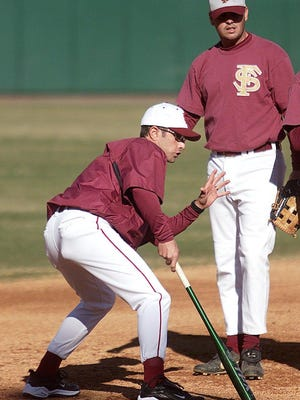 Link Jarrett, left, was a starting shortstop on three FSU College World Series teams and was a volunteer coach for the Seminoles in 2003.