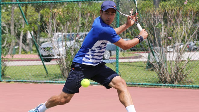 Japan's Ryota Kishi prepares for a backhand return against Korea Republic's Kwon Oh-Hee in a Day 3 singles match of the 2017 King's Guam Futures tennis tournament, an ITF Pro Circuit event presented by Docomo Pacific and Hilton Guam Resort & Spa at the Hilton tennis courts Wednesday. Kwon won 7-5, 6-2..